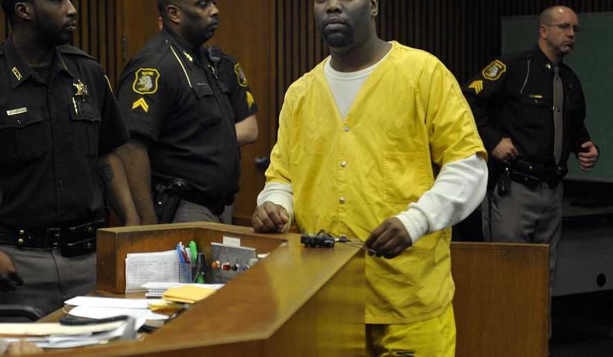 Michael Lawson waits to be sentenced at Wayne County Circuit Court in Detroit, Monday, Jan. 5, 2015 for the murder of Marcel Jackson, an anti-crime advocate and Detroit nightclub bouncer. Lawson will be sentenced at a later date. (AP Photo/The Detroit News, Charles V. Tines) DETROIT FREE PRESS OUT, HUFFINGTON POST OUT