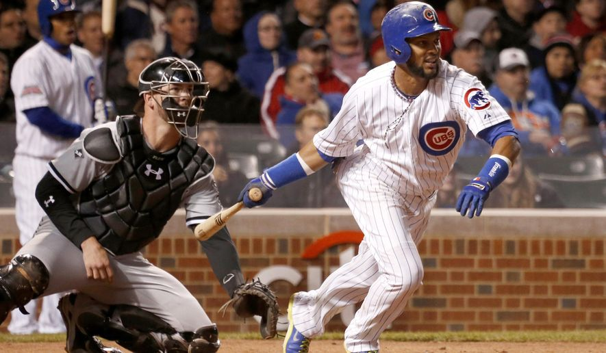 FILE - In this May 6, 2014, file photo, Chicago Cubs' Emilio Bonifacio, right, and Chicago White Sox catcher Tyler Flowers watch Bonifacio's RBI single off a pitch from Hector Noesi, scoring Junior Lake, during the fifth inning of an interleague baseball game in Chicago. A person familiar with the situation says the Chicago White Sox have agreed to a $4 million, one-year contract with veteran utility player Emilio Bonifacio that includes a club option for 2016. The person spoke Monday, Jan. 5, 2015,  on the condition of anonymity because the deal is pending a physical. (AP Photo/Charles Rex Arbogast, File)
