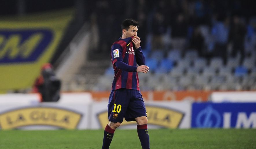 Barcelona's Lionel Messi of Argentina leaves the pitch at the end of the match during their La Liga soccer match against Real Sociedad, at Anoeta stadium in San Sebastian, northern Spain, Sunday, Jan.4, 2015.  Barcelona lose the match 1-0.(AP Photo/Alvaro Barrientos)