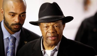 Former Mayor and current DC City Council member Marion Barry, right, arrives with his son Christopher Barry, at a media availability to endorse Mayor Vincent Gray's bid for re-election, Wednesday, March 19, 2014 in Washington. (AP Photo/Alex Brandon) (Associated Press)