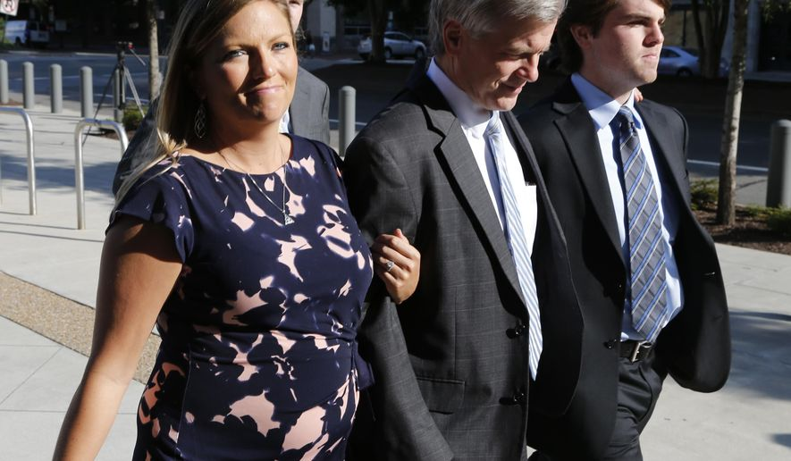 FILE - In this Friday, Aug. 29, 2014 file photo, former Virginia Gov. Bob McDonnell, center, arrives at Federal Court with his daughter Jeanine McDonnell Zubowsky, left and son Bobby, McDonnell, right,  in Richmond, Va.  The judge in the case will sentence McDonnell Tuesday, Jan. 6, 2015, and has received over 400 letters of support for the former governor.   (AP Photo/Steve Helber, File)