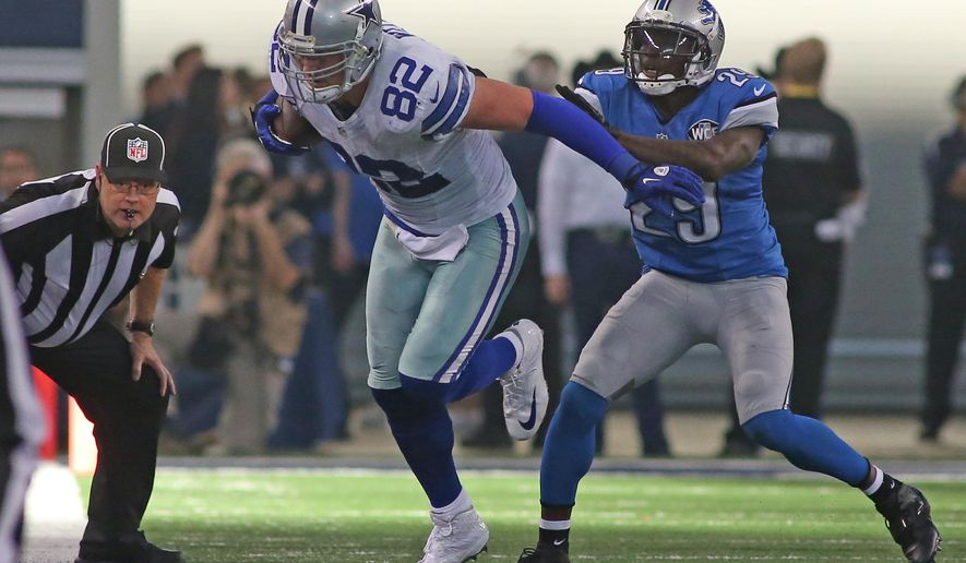 Dallas Cowboys tight end Jason Witten (82) gets a shove out of bounds by Detroit Lions cornerback Cassius Vaughn (29)  during the second quarter of an NFL wildcard playoff football game, Sunday, Jan. 4, 2015, in Arlington, Texas. (AP Photo/The Fort Worth Star-Telegram, Paul Moseley)  MAGS OUT; (FORT WORTH WEEKLY, 360 WEST); INTERNET OUT