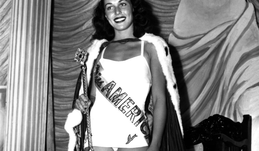 FILE - In this Sept. 8, 1945 file photo, Bess Myerson, of New York, holds the scepter after being crowned Miss America 1945 at the annual Miss America pageant in Atlantic City, N.J. Myerson, the first Jewish Miss America who parlayed her stunning 1945 victory into national celebrity, died Dec. 14, 2014, at her home in Santa Monica, Calif. She was 90. (AP Photo, File)