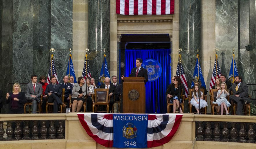 Wisconsin Gov. Scott Walker addresses the crowd after being inaugurated for his second term at the Capitol, Monday, Jan. 5, 2015, in Madison, Wis. (AP Photo/Andy Manis)