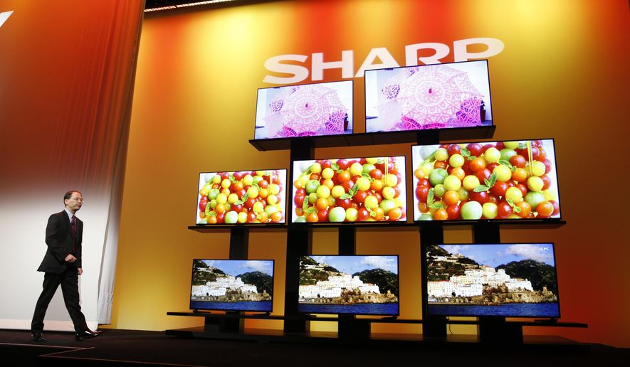 Toshiyuki Osawa, president of Sharp Electronics Corporation, introduces Sharp 4K Ultra HD televisions Monday, Jan. 5, 2015, at the International CES in Las Vegas. Also known as Ultra HD, 4k offers four times the sharpness of today's high-definition video. (AP Photo/John Locher)