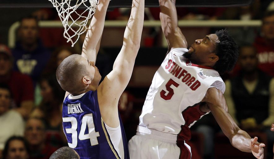 Stanford guard Chasson Randle (5) dunks over Washington center Gilles Dierickx (34) during the first half of an NCAA college basketball game Sunday, Jan. 4, 2015, in Stanford, Calif. (AP Photo/Marcio Jose Sanchez)
