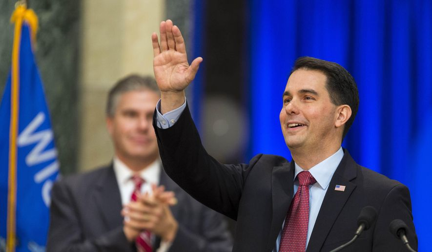 Wisconsin Gov. Scott Walker acknowledges the crowd after being inaugurated for his second term, Monday, Jan. 5, 2015, in Madison, Wis. (AP Photo/Andy Manis)