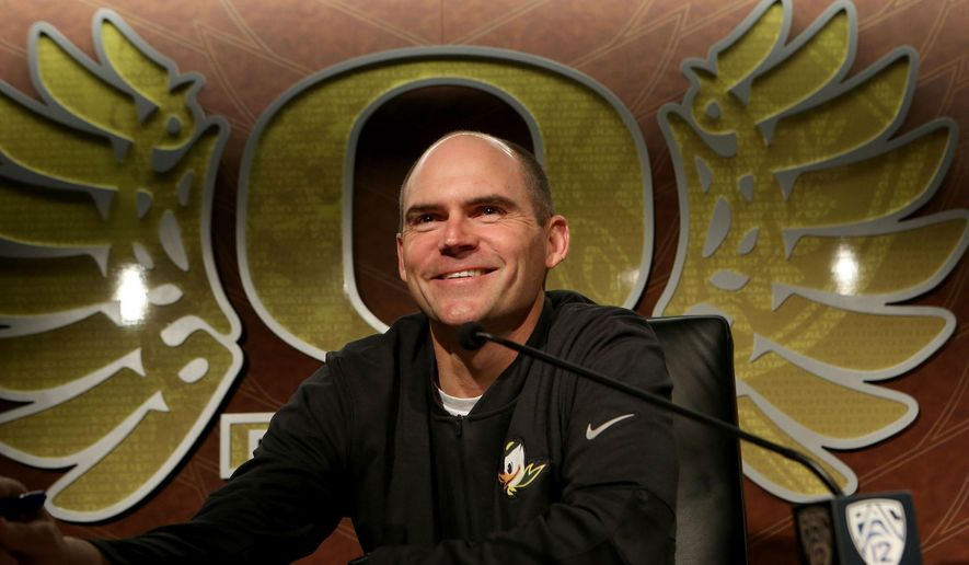Oregon coach Mark Helfrich takes questions from reporters Monday, Jan. 5, 2015, in Eugene, Ore., after the team's first practice since the Rose Bowl. Oregon faces Ohio State on Jan. 12 in the title game in college football's first playoff. (AP Photo/The Register-Guard, Chris Pietsch)