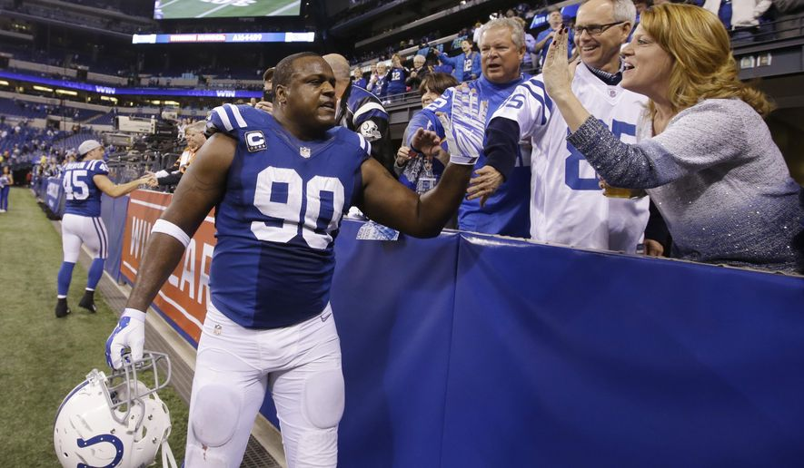 Indianapolis Colts' Cory Redding (90) celebrates with fans following an NFL wildcard playoff football game against the Cincinnati Bengals, Sunday, Jan. 4, 2015, in Indianapolis. Indianapolis defeated Cincinnati 26-10. (AP Photo/Darron Cummings)