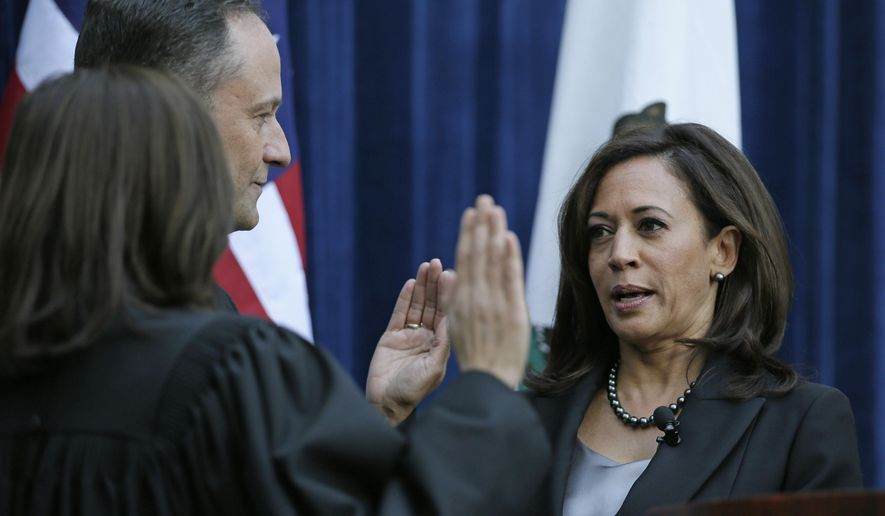 California Attorney General Kamala Harris takes the oath of office from California Supreme Court Chief Justice Tani Cantil-Sakauye as her husband, Douglas Emhoff, looks on at the Crocker Art Museum Monday, Jan. 5, 2015, in Sacramento, Calif. Harris touted her fight against organized human trafficking after being sworn in to her second four-year term as California's top law enforcement official. Among the brightest Democratic stars, Harris is widely expected to be preparing for a run for governor or U.S. Senate. (AP Photo/Eric Risberg)