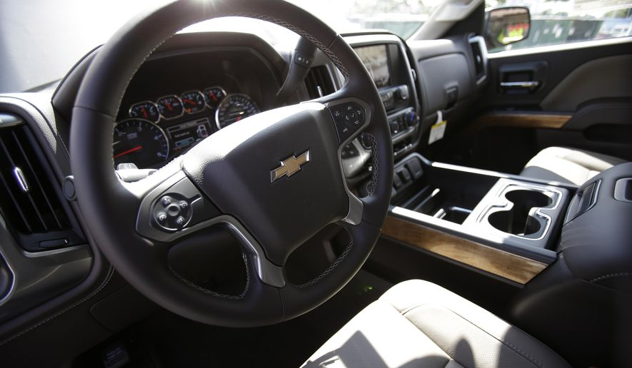 In this Wednesday, Oct. 1, 2014 photo, the interior of a 2015 Chevrolet Silverado 2500 4WD LTZ Crew Cab pickup truck is shown at Miami Lakes AutoMall in Miami Lakes, Fla. All major automakers report U.S. sales on Monday, Jan. 5, 2015. (AP Photo/Wilfredo Lee)