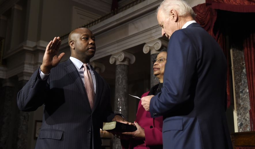 Vice President Joe Biden administers the ceremonial Senate oath to Sen. Tim Scott, R-S.C., during a ceremony in the Old Senate Chamber on Capitol Hill in Washington, Tuesday, Dec. 2, 2014. Scott's mother Frances Scott holds the bible. Earlier, Scott was officially sworn in by Biden of the floor of the Senate. (AP Photo/Susan Walsh)