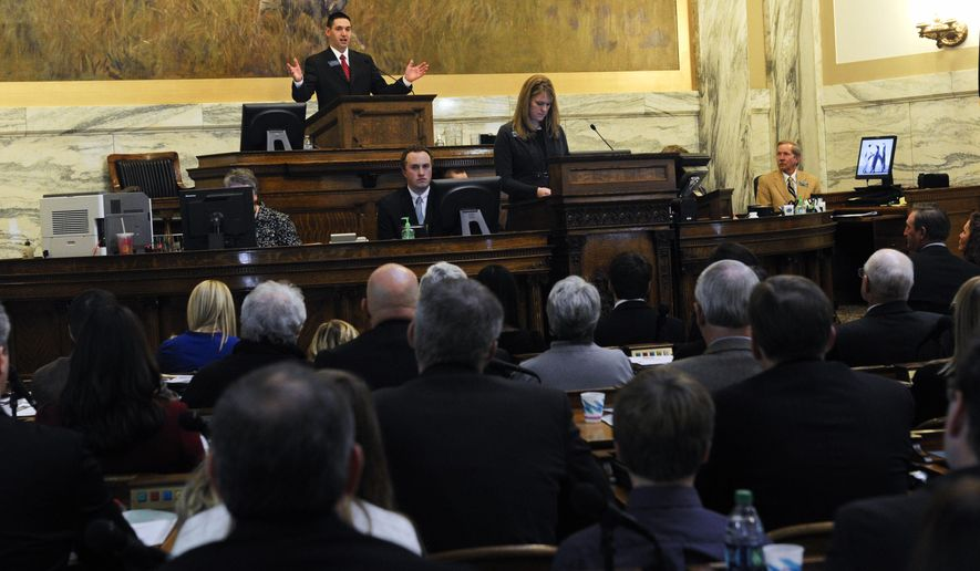 After elected Speaker of the House, Rep. Austin Knudsen, R-Culbertson, addresses the 64th Montana Legislature on its opening day, Monday, Jan. 5, 2015 at the State Capitol in Helena, Mont. (AP Photo/Independent Record, Thom Bridge)