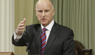 California Gov. Jerry Brown gestures while delivering his inaugural address at the state Capitol Monday, Jan. 5, 2015, in Sacramento, Calif. When Brown takes the oath of office Monday, it will be the first time a California governor will be sworn in to a fourth term. The 76-year-old Democrat, who held office from 1975 to 1983 before term limits and returned for a third term in 2011, delivered a joint inauguration and state of the state address in the Assembly chamber at the state Capitol. (AP Photo/Rich Pedroncelli)