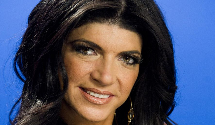 This Jan. 4, 2012, photo shows Teresa Giudice posing for a portrait in New York. (AP Photo/Charles Sykes, File)