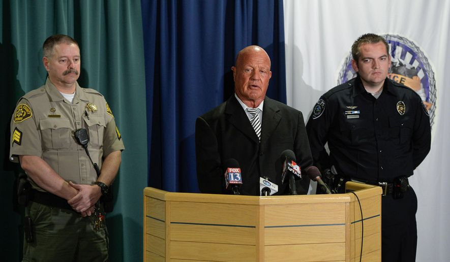 Salt Lake County Sheriff's Sgt. Terry Wall, and from left, Robert Odor and Cody Stromberg took action to stop an unruly passenger on a flight from New York to Salt Lake City speak about the ordeal during a news conference at the Salt Lake County Sheriff Department on Monday, Jan. 5, 2015, in Salt Lake City. The Utah officers say they helped restrain the woman about an hour into the flight when she had a medical issue and became combative. (AP Photo/The Salt Lake Tribune, Francisco Kjolseth)