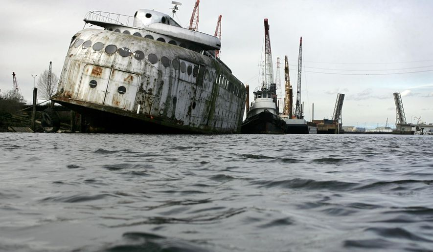 FILE - In a March 24, 2011 file photo, the 276-foot ferryboat Kalakala lists in its mooring on the Hylebos Waterway, in Tacoma. The historic ferry Kalakala has reached its final destination. The News Tribune reports the owner plans to have the rusting hulk scrapped later in January 2015 in Tacoma, Wash. The 276-foot ferry went into service in 1935 and carried cars across Puget Sound until 1967.  (AP Photo/ The News Tribune, Janet Jensen, File)