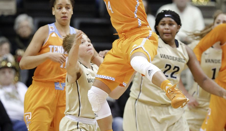 Tennessee guard Andraya Carter (14) grabs a rebound over Vanderbilt guard Jasmine Jenkins, second from left, in the second half of an NCAA college basketball game Monday, Jan. 5, 2015, in Nashville, Tenn. Tennessee won 57-49. (AP Photo/Mark Humphrey)