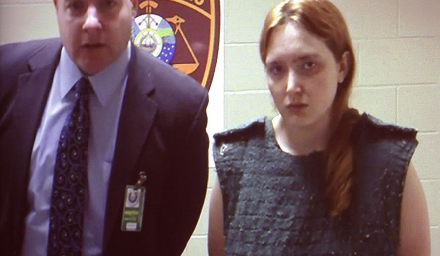 Katlyn Marin appears in a video arraignment from the Department of Corrections jail in Manchester, N.H. on Monday, Jan. 5, 2015, in the District Courtroom in Nashua, N.H. Marin was charged with second-degree murder in the beating death of her 3-year-old daughter. (AP Photo/The Telegraph, Don Himsel, Pool)