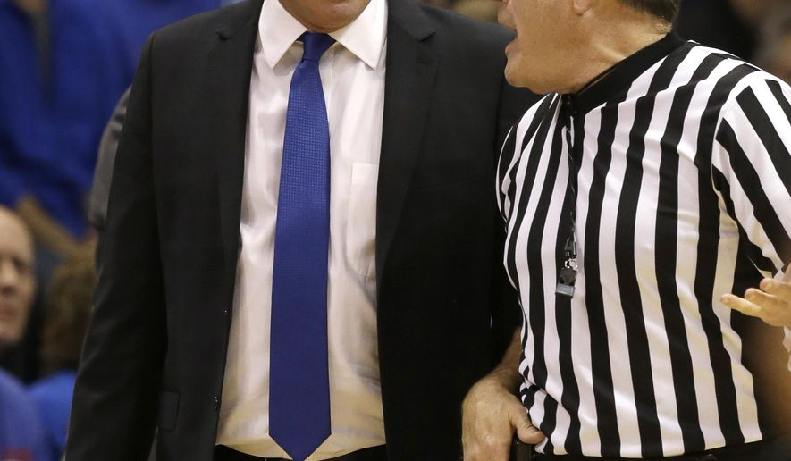 Kansas head coach Bill Self, left, has words with referee Gerry Pollard, right, during the second half of an NCAA college basketball game UNLV in Lawrence, Kan., Sunday, Jan. 4, 2015.  Kansas defeated UNLV 76-61. (AP Photo/Orlin Wagner)