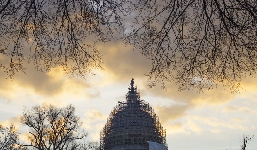 The sun rises over the Capitol in Washington, Monday, Jan. 5, 2015, as the 114th Congress prepares to open Tuesday with Republicans in the majority in both the House and Senate. (AP Photo/J. Scott Applewhite)