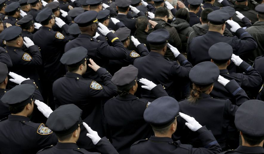 Police officer salute during the funeral of Officer Wenjian Liu in the Brooklyn borough of New York, Sunday, Jan. 4, 2015. Liu and his partner, officer Rafael Ramos, were killed Dec. 20 as they sat in their patrol car on a Brooklyn street. The shooter, Ismaaiyl Brinsley, later killed himself.   (AP Photo/Seth Wenig)