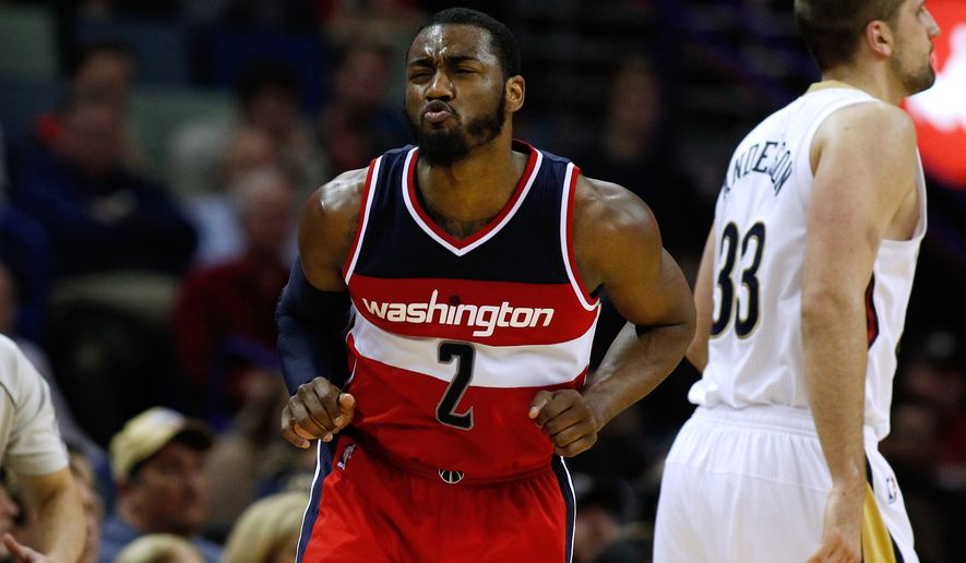 Washington Wizards guard John Wall (2) celebrates after scoring during the second half of an NBA basketball game against the New Orleans Pelicans, Monday, Jan. 5, 2015, in New Orleans. The Wizards won 92-85. (AP Photo/Jonathan Bachman)