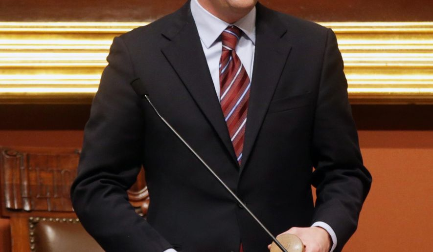 Minnesota House Speaker Kurt Daudt holds his new gavel as members applauded following his election to speaker as the 2015 session of the Minnesota Legislature got underway, Tuesday, Jan. 6, 2015 in St. Paul, Minn.  (AP Photo/Jim Mone)