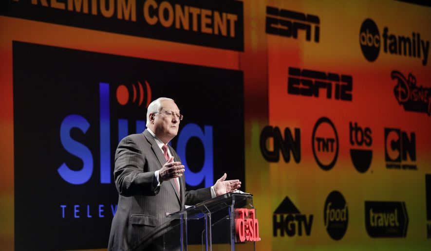 Joe Clayton, president and CEO of Dish Network, introduces the Sling TV, a live television streaming service, at a news conference at the International CES, Monday, Jan. 5, 2015, in Las Vegas. Standout features in many of the TV sets out this year will be more useful for streaming Internet video than watching broadcast or cable channels. In addition, satellite TV provider Dish Network Corp. will offer a package of channels, including ESPN and CNN, for delivery entirely over the Internet, starting at $20 a month. (AP Photo/Jae C. Hong)