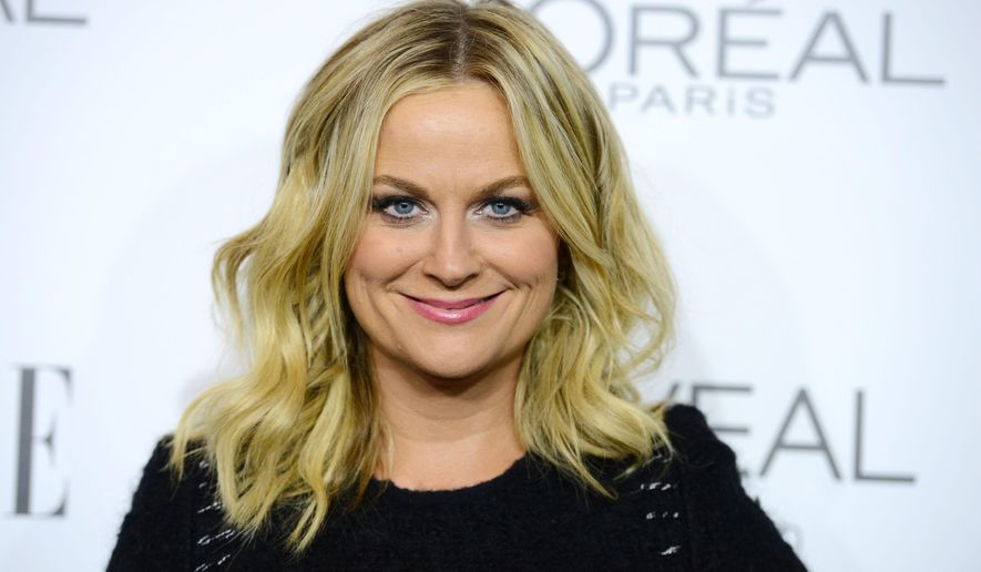 """FILE - In this Oct. 20, 2014 file photo, Amy Poehler arrives at ELLE's 21st annual Women In Hollywood Awards at the Four Season Hotel in Los Angeles. Poehler has been named 2015 Woman of the Year by Harvard University's Hasty Pudding Theatricals. The group said Tuesday, Jan. 6, 2015, Poehler's comedy """"fits so well with the Pudding's own tradition of satire and social commentary.""""  (Photo by Jordan Strauss/Invision/AP, File)"""