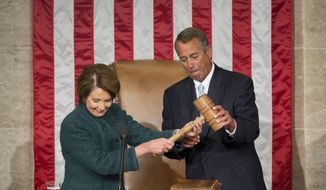 House Speaker John Boehner of Ohio, is handed the gavel from House Minority Leader Nancy Pelosi of Calif. after being re-elected for a third term to lead the 114th Congress, as Republicans assume full control for the first time in eight years, Tuesday, Jan. 6, 2015, on Capitol Hill in Washington. (AP Photo/Pablo Martinez Monsivais )