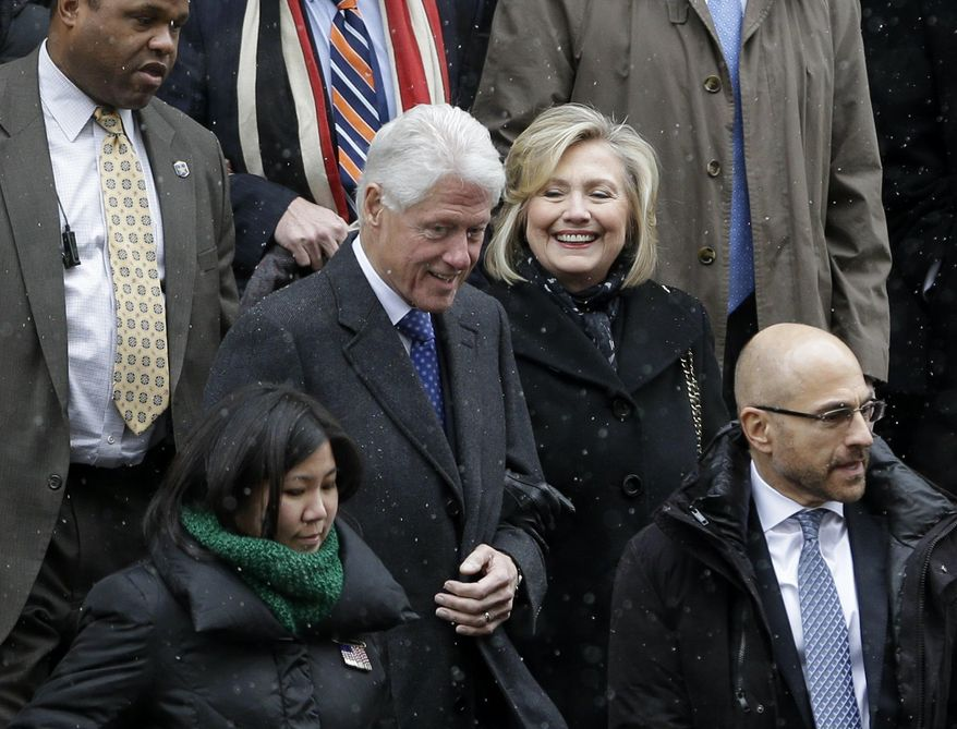 Bill and Hillary Clinton, center, greet people as they exit the funeral for Mario Cuomo at the Church of St. Ignatius Loyola in New York, Tuesday, Jan. 6, 2015. (AP Photo/Seth Wenig)