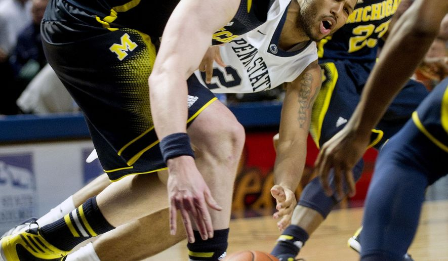 Michigan's Ricky Doyle steals the ball from Penn State's D.J. Newbill during an NCAA college basketball game, Tuesday, Jan. 6, 2015 game at the Bryce Jordan Center in University Park, Pa.  Michigan won, 73-64. (AP Photo/Centre Daily Times, Abby Drey) MANDATORY CREDIT; MAGS OUT