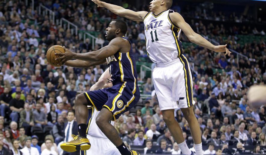 Indiana Pacers guard Rodney Stuckey (2) goes to the basket as Utah Jazz guard Dante Exum (11) defends in the second quarter during an NBA basketball game Monday, Jan. 5, 2015, in Salt Lake City. (AP Photo/Rick Bowmer)