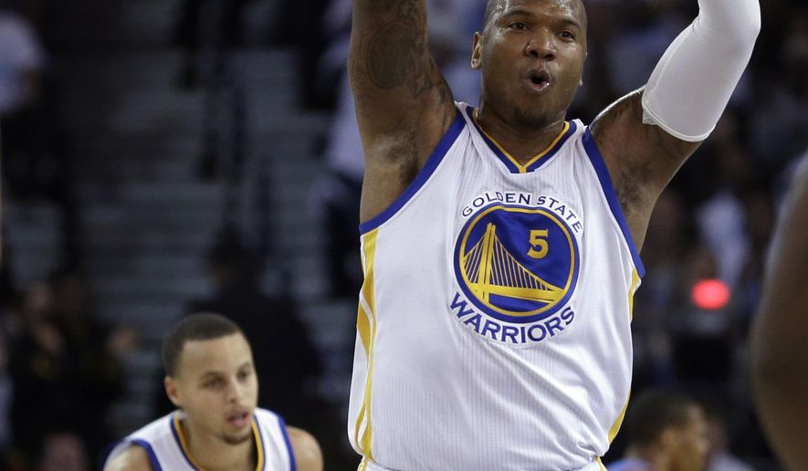 Golden State Warriors' Marresse Speights (5) celebrates a score against the Oklahoma City Thunder during the first half of an NBA basketball game Monday, Jan. 5, 2015, in Oakland, Calif. (AP Photo/Ben Margot)
