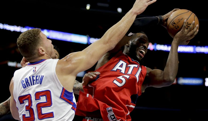 Los Angeles Clippers forward Blake Griffin blocks a shot by Atlanta Hawks forward DeMarre Carroll during the first half of an NBA basketball game in Los Angeles, Monday, Jan. 5, 2015. (AP Photo/Chris Carlson)