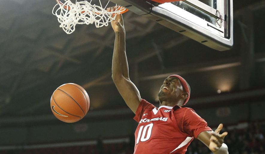 Arkansas forward Bobby Portis (10) scores in the first half of an NCAA college basketball game  Tuesday, Jan. 6, 2015, in Athens, Ga.  (AP Photo/John Bazemore)