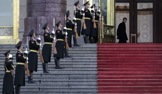 A Chinese officer, top right, looks as members of honor guard rehearse for a welcome ceremony held by Chinese President Xi Jinping for visiting Costa Rica's President Luis Guillermo Solis at the main entrance of the Great Hall of the People in Beijing, China Tuesday, Jan. 6, 2015. (AP Photo/Andy Wong)