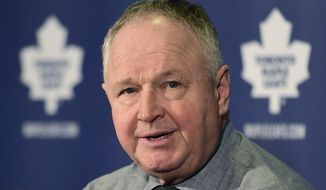 FILE - In this Nov. 18, 2014, file photo, Toronto Maple Leafs coach Randy Carlyle speaks to the media following the team's 9-2 loss to the Nashville Predators in an NHL hockey game in Toronto. The Maple Leafs fired Carlyle Tuesday, Jan. 6, 2014. (AP Photo/The Canadian Press, Frank Gunn, File)