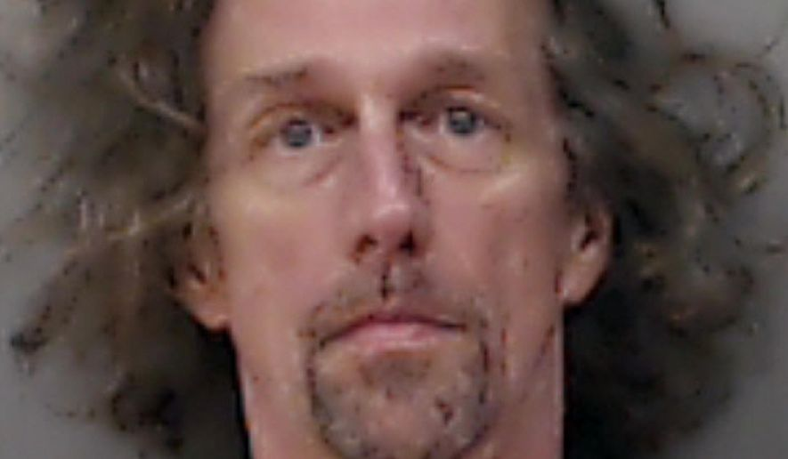 In this photo provided by the Linn County Jail in Cedar Rapids, Iowa, is Matthew Samuel West, 49. The  Iowa man who fled authorities in 1994 while facing LSD charges is back in custody more than 20 years later. (AP Photo/Linn County Jail)