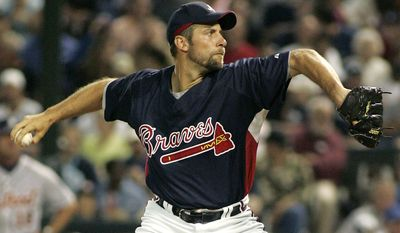 FILE - In this March 27, 2007, file photo, Atlanta Braves pitcher John Smoltz throws in the fourth inning of a spring training baseball game against the Detroit Tigers in Lake Buena Vista, Fla. Smoltz was elected to the National Baseball Hall of Fame on Tuesday, Jan. 6, 2015.  (AP Photo/Reinhold Matay, File)