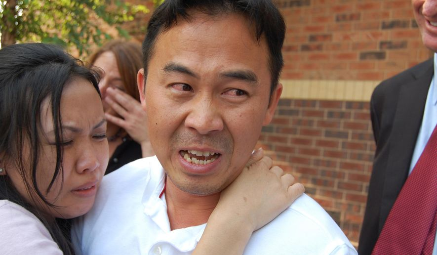 FILE - In this Aug. 5, 2010, file photo, Koua Fong Lee embraces his wife, Panghoua Moua, in St. Paul, Minn., after learning charges against him, including criminal vehicular homicide, were dropped. Eight years after a crash involving a Toyota Camry driven by Lee that killed three Minnesota residents and resulted in a prison sentence for him, a lawsuit against the automaker goes to trial Wednesday, Jan. 7, 2015. (AP Photo/Minnesota Public Radio, Tom Weber, File)