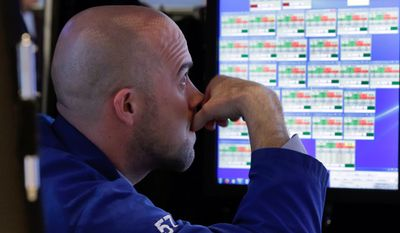 Specialist Jarret Johnson works at his post on the floor of the New York Stock Exchange, Tuesday, Jan. 6, 2015. Stocks turned lower in mid-morning trading Tuesday, extending a slump from a day earlier. The price of oil continued to slide and the yield on the 10-year Treasury note fell below 2 percent.  (AP Photo/Richard Drew)