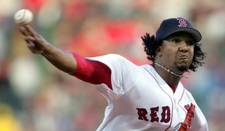FILE - In this Oct. 18, 2004, file photo, Boston Red Sox starter Pedro Martinez throws to the New York Yankees in the first inning of Game 5 of the ALCS in Boston. Martinez was elected to the National Baseball Hall of Fame Tuesday, Jan. 6, 2015. (AP Photo/Charles Krupa, File)