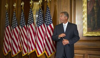 House Speaker John Boehner of Ohio waits for the next Member of Congress to pose for a photograph during a ceremonial re-enactment of the House oath-of-office, Tuesday, Jan. 6, 2015, on Capitol Hill in Washington. (AP Photo/Cliff Owen)