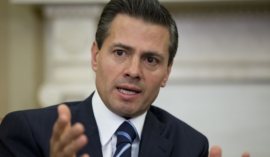 Mexican President Enrique Pena Nieto speaks to media during a bilateral meeting with President Barack Obama in the Oval Office of the White House in Washington, Tuesday, Jan. 6, 2015. Obama is looking to his southern neighbor for help implementing the changing policies on immigration and Cuba. (AP Photo/Carolyn Kaster)