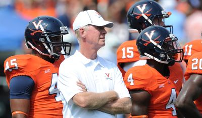 Virginia tight ends coach Tom O'Brien supervises drills during a training camp practice. O'Brien, 66, announced his retirement on Tuesday, Jan. 6, 2014 after two years at the university and a 40-year coaching career that included stops as the head coach at Boston College and N.C. State. (Courtesy of University of Virginia athletic department)