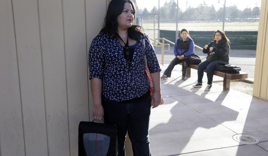 Debora Avalos waits for the start of her GED class at Del Mar High School Wednesday, Jan. 7, 2015, in San Jose, Calif. Avalos wrote a letter to the governor about the need to increase funding for adult education because she hopes to pursue a career in nursing to help her husband, who works two jobs. Democratic Gov. Jerry Brown is getting pressure from members of his own party to spend some of the state's surplus on welfare, health care, child care and other social programs to assist those who are missing out on the economic recovery. California is currently enjoying an influx of tax revenue but Brown is expected to release a budget proposal Friday that emphasizes restraint and savings for a rainy day. (AP Photo/Marcio Jose Sanchez)