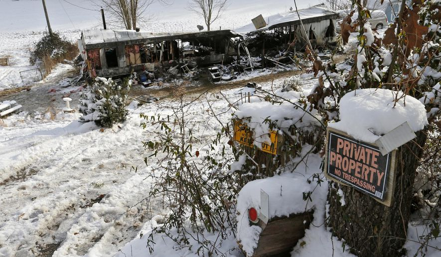 In this Tuesday, Jan 6, 2015 photo, snow surrounds the remains of a trailer after a fire which killed five people early in the morning near Sugar Grove, Ohio. A 62-year-old woman whose baby great-grandson was among 5 killed in a fire that roared through her southeast Ohio trailer home remains in critical condition. The incident was the third multiple-death home fire in Ohio in less than four weeks. (AP photo/Columbus Dispatch, Barbara J. Perenic)