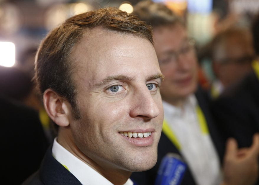 French finance minister Emmanuel Macron tours the Parrot booth at the International CES Tuesday, Jan. 6, 2015, in Las Vegas. (AP Photo/John Locher)